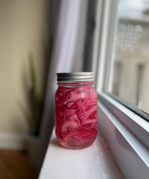 Pickled red onions in mason jar
